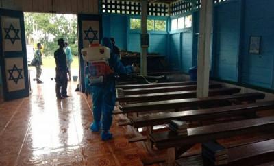 Aksi Nyata Satgas TNI Cegah Penyebaran Corona di Gereja