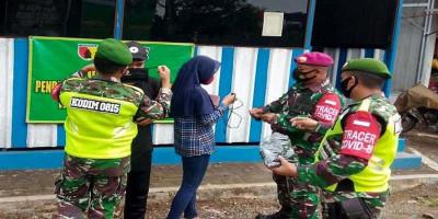 Tingkatkan Disiplin Masyarakat, Prajurit Yonif 1 Brigif 2 Mar Pasmar 2 Laksanakan Operasi Protokol Kesehatan