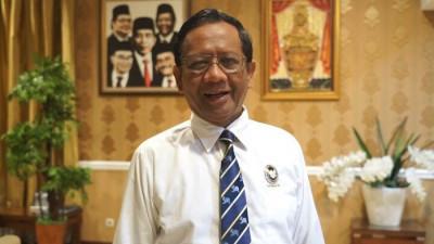 Mahfud MD: Presiden Jokowi Tak Ingin Masalah Papua Diselesaikan dengan Kokangan Senjata